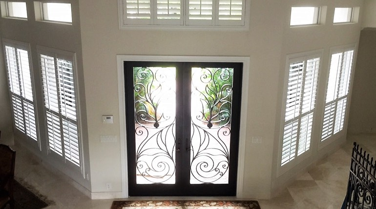 Las Vegas foyer with glass doors and interior shutters