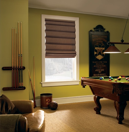 Roman shades in Las Vegas game room with green walls.