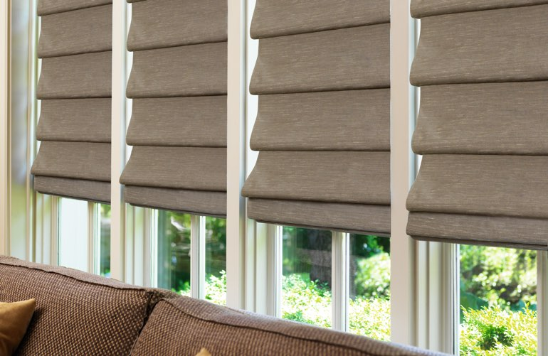 Roman shades covering window in sunroom