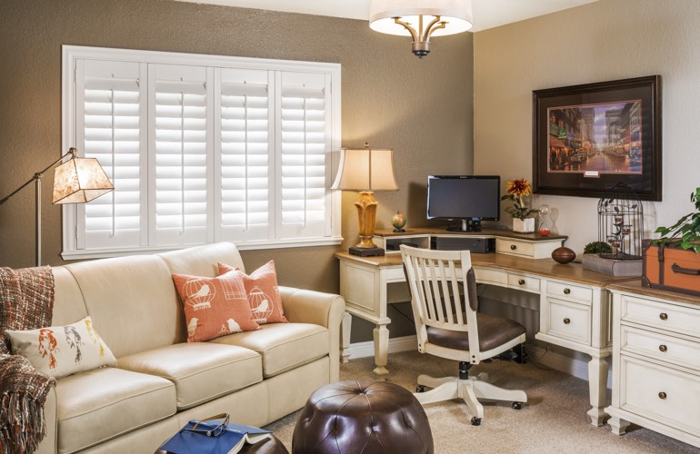 Las Vegas home office with white window shutters.